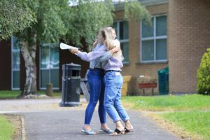 Leagh Kerr and Ellen O'Hara celebrate after getting theor A-Level results from Lismore Comprehensive School in Craigavon, County Armagh, Thursday, August 15, 2019. (Photo by Paul McErlane for the Belfast Telegraph)