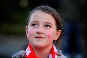 LIVERPOOL, ENGLAND - APRIL 27: A young girl with the figure 96 painted on her face attends a vigil for the 96 victims of the Hillsborough tragedy  outside Liverpool's Saint George's Hall on April 27, 2016 in Liverpool, England. The civic commemoration event marks the outcome of the fresh inquests into the 1989 Hillsborough disaster, in which 96 football supporters were crushed to death, and concluded yesterday with a verdict of unlawful killing. Relatives, Liverpool supporters and members of the public are taking part in the vigil at St George's Hall where a candle is lit for each of the 96 victims who lost their lives during a crush at the Hillsborough football ground in Sheffield, South Yorkshire in 1989..  (Photo by Christopher Furlong/Getty Images)