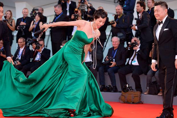 "A guest falls on the red carpet before the premiere of the movie ""The Light Between Oceans"" presented in competition at the 73rd Venice Film Festival on September 1, 2016 at Venice Lido. AFP/Getty Images"