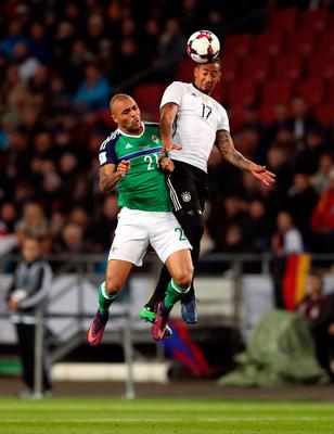 Germany's Jerome Boateng (right) and Northern Ireland's Josh Magennis battle for the ball in the air during the 2018 FIFA World Cup Qualifying match at the HDI Arena, Hannover. PA
