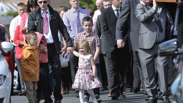 Funeral of West Belfast murder victim Jennifer Dornan as it leaves her Mothers home at Wolflink Link, Belfast. Pictured back right carrying her coffin is her Father Stephen Dornan, also pictured are her three children, Jayden, (6) Martin (8) and Abbie (3).Picture by  Stephen Hamilton / Press Eye.com