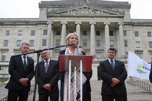 PACEMAKER BELFAST  04/09/2015 The Minister of Agriculture and Rural Development Michelle O'Neil speaks to disgruntled farmers outside Stormont. Farmers, processers and retailers have held a protest at Stormont to highlight volatility in prices. It was organised by the Ulster Farmers' Union (UFU) and comes ahead of Monday's key EU farm ministers summit on the crisis in the dairy industry. Picture Matt Bohill/Pacemaker Press