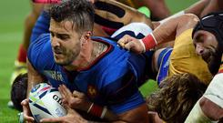 France's wing Sofiane Guitoune scores his team's third try during a Pool D match of the 2015 Rugby World Cup between France and Romania at the Olympic stadium, east London, on September 23, 2015. AFP/Getty Images
