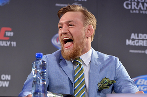 UFC featherweight title challenger Conor 'The Notorious' McGregor laughs at Champion Jose Aldo.