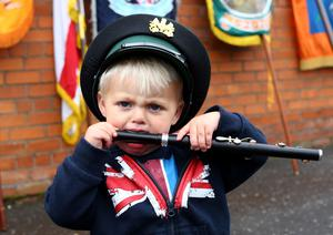 13th July 2015   ?William Cherry/Presseye  Two year old Kyle Smith will follow lodges and bands as they leave Lisburn City Centre on their way to the field in Fullerton Park, Dunmurry. A total of 18 demonstrations are being held as part of the Twelfth of July commemorations around the Province.