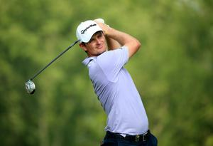 LOUISVILLE, KY - AUGUST 10: Justin Rose of England hits his tee shot on the 12th hole during the final round of the 96th PGA Championship at Valhalla Golf Club on August 10, 2014 in Louisville, Kentucky.  (Photo by Andrew Redington/Getty Images)