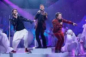 The remaining members of Take That, Howard Donald, Gary Barlow and Mark Owen,  preform on stage for An Evening With Take That on ITV