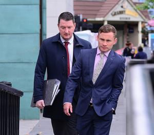 Former boxing world champion, Carl Frampton arrives at Belfast High court with his legal counsel, John Finucane for his legal battle with his former manager, Barry McGuigan. Picture By: Arthur Allison/ Pacemaker Press