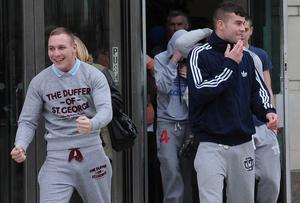 (L-R) Christopher Kirkwood and Jamie Morrow leave with supporters at Laganside Court in Belfast on Thursday as four men from east Belfast have been given six-month suspended prison sentences for animal cruelty offences. Pacemaker