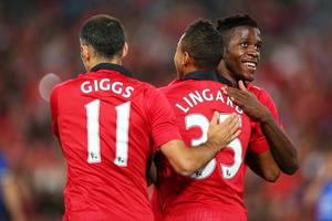 SYDNEY, AUSTRALIA - JULY 20:  Jesse Lingard of Manchester United celebrates with team mates Ryan Giggs and Wilfried Zaha after scoring the opening goal during the match between the A-League All-Stars and Manchester United at ANZ Stadium on July 20, 2013 in Sydney, Australia.  (Photo by Brendon Thorne/Getty Images)