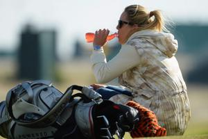 GULLANE, SCOTLAND - JULY 15:  Skier Lindsey Vonn watches Tiger Woods of the United States ahead of the 142nd Open Championship at Muirfield on July 15, 2013 in Gullane, Scotland.  (Photo by Stuart Franklin/Getty Images)