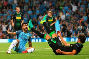 MANCHESTER, ENGLAND - SEPTEMBER 14: Sergio Aguero of Manchester City reacts to a challenge from Tobias Strobl of Borussia Moenchengladbach during the UEFA Champions League match between Manchester City FC and VfL Borussia Moenchengladbach at Etihad Stadium on September 14, 2016 in Manchester, England.  (Photo by Alex Livesey/Getty Images)