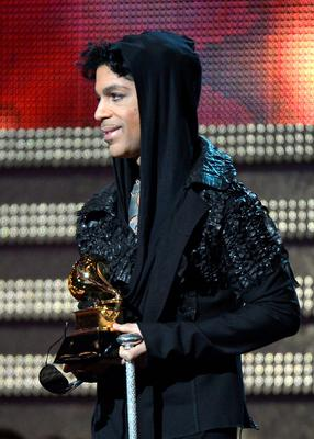 (FILES) This file photo taken on February 10, 2013 shows musician Prince as he presents the winner for Record of the Year during the 55th Grammy Awards in Los Angeles, California.  Pop icon Prince -- one of the most influential but elusive figures in music -- has died at his compound in Minnesota, entertainment website TMZ reported on April 21, 2016, citing unnamed sources. Local authorities said a death investigation was underway at Prince's Paisley Park complex, but did not give the identity of the fatality.  / AFP PHOTO / JOE KLAMARJOE KLAMAR/AFP/Getty Images