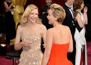 HOLLYWOOD, CA - MARCH 02:  Actresses Cate Blanchett (L) and Jennifer Lawrence attend the Oscars held at Hollywood & Highland Center on March 2, 2014 in Hollywood, California.  (Photo by Michael Buckner/Getty Images)