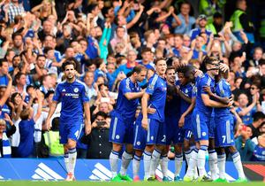 Chelsea players celebrate after scoring their second goal during the English Premier League football match between Chelsea and Arsenal at Stamford Bridge in London on September 19, 2015. Chelsea won the game 2-0. AFP PHOTO / BEN STANSALL  RESTRICTED TO EDITORIAL USE. No use with unauthorized audio, video, data, fixture lists, club/league logos or 'live' services. Online in-match use limited to 75 images, no video emulation. No use in betting, games or single club/league/player publications.BEN STANSALL/AFP/Getty Images