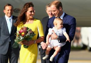 Prince William, Duke of Cambridge, Catherine, Duchess of Cambridge and Prince George of Cambridge arrive at Sydney Airport on RAAF B737 on April 16, 2014 in Sydney, Australia. The Duke and Duchess of Cambridge are on a three-week tour of Australia and New Zealand, the first official trip overseas with their son, Prince George of Cambridge.  (Photo by Ryan Pierse/Getty Images)