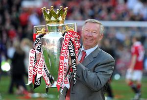 File photo dated 22/05/2011 of Manchester United manager Sir Alex Ferguson celebrates with the Premier League trophy. PRESS ASSOCITAION Photo. Issue date: Wednesday May 8, 2013. Sir Alex Ferguson will retire at the end of this season, Manchester United have announced. See PA Story SOCCER Man Utd. Photo credit should read: Martin Rickett/PA Wire.