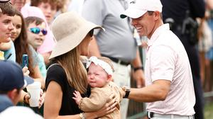 Rory McIlroy of Northern Ireland celebrates with his wife Erica and daughter Poppy after winning during the final round of the 2021 Wells Fargo Championship at Quail Hollow Club on May 09, 2021 in Charlotte, North Carolina. (Photo by Maddie Meyer/Getty Images)