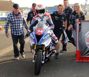 PACEMAKER BELFAST  11/05/2017 Alastair Seeley celebrates victory in the Superstock race at the Vauxhall International North West 200 on Thursday evening.  This is Seeley's 28th Podium and The Was teams 25 win at the North West 200 He is welcomed into the winners enclosure by team mechanics and family Photo Stephen Davison/Pacemaker Press