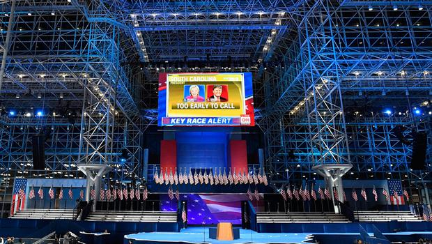 A screen displaying the election results is seen over the stage that Democratic presidential nominee Hillary Clinton will speak later during election night at the Jacob K. Javits Convention Center in New York on November 8, 2016.  / AFP PHOTO / Jewel SAMADJEWEL SAMAD/AFP/Getty Images