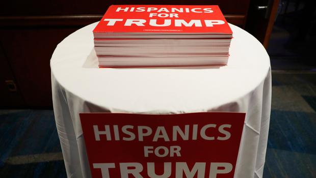 "NEW YORK, NY - NOVEMBER 08:  Signs in support of Republican presidential nominee Donald Trump read ""Hispanics for Trump"" at the New York Hilton Midtown on November 8, 2016 in New York City. Americans today will choose between Republican presidential nominee Donald Trump and Democratic presidential nominee Hillary Clinton as they go to the polls to vote for the next president of the United States.  (Photo by Chip Somodevilla/Getty Images)"