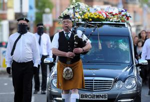 A colour party  during  the funeral  of Tommy Crossan at St John's Church on the Falls Road in West Belfast. Pic Colm Lenaghan/Pacemaker