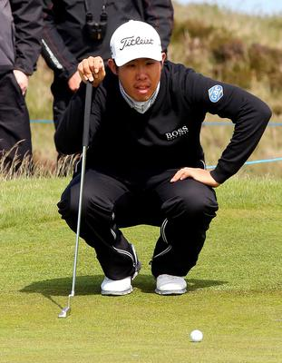 South Korea's An Byeong-Hun lines up his putt on the 11th green on the first day of the Irish Open at the Royal County Down Golf Club in Newcastle in Northern Ireland on May 28, 2015.  AFP PHOTO / PAUL FAITHPAUL FAITH/AFP/Getty Images