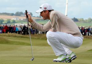 Ireland's Padraig Harrington lines up his putt on the 18th green on the first day of the Irish Open at the Royal County Down Golf Club in Newcastle in Northern Ireland on May 28, 2015.      AFP PHOTO / PAUL FAITHPAUL FAITH/AFP/Getty Images