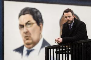 SDLP leader Colum Eastwood close to a painted mural of former SDLP John Hume in the Bogside of Derry City (Liam McBurney/PA)