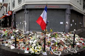 "The French national flag, candles and flowers are seen on November 17, 2015 at a makeshift memorial in front of the ""Le petit Cambodge"" restaurant in Paris, in tribute to the victims of the attacks claimed by Islamic State which killed at least 129 people and left more than 350 injured on November 13. AFP PHOTO / KENZO TRIBOUILLARDKENZO TRIBOUILLARD/AFP/Getty Images"