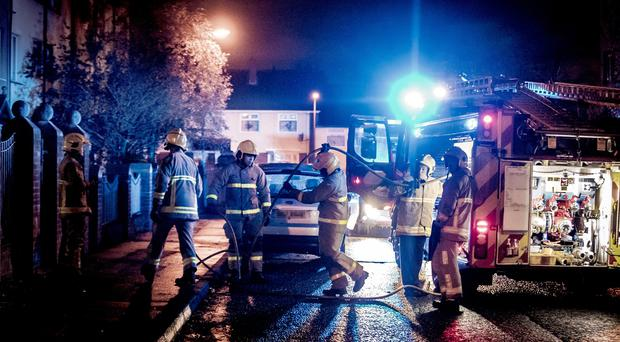 Firefighters deal with a blaze at an apartment block in the Rossnareen Drive area of west Belfast on November 4th 2019 (Photo by Kevin Scott for Belfast Telegraph)