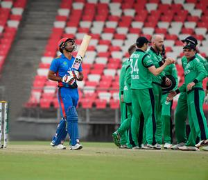 On target: Ireland's James Cameron-Dow after taking wicket of Gulbadin Naib yesterday