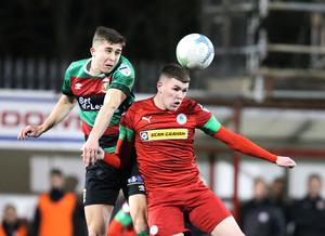 Cliftonville's Aaron Donnelly and Paul O'Neill of Glentoran compete for the ball (INPHO/Brian Little)