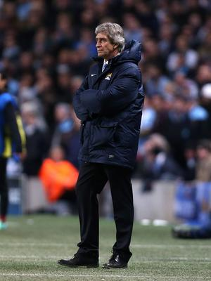 Manchester City's manager Manuel Pellegrini on the touchline during the UEFA Champions League, Round of 16 match at the Etihad Stadium, Manchester. PRESS ASSOCIATION Photo. Picture date: Tuesday February 18, 2014. See PA story SOCCER Man City. Photo credit should read: Peter Byrne/PA Wire