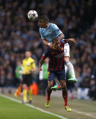 Barcelona's da Silva Dani Alves and Manchester City's Aleksandar Kolarov (top) during the UEFA Champions League, Round of 16 match at the Etihad Stadium, Manchester. PRESS ASSOCIATION Photo. Picture date: Tuesday February 18, 2014. See PA story SOCCER Man City. Photo credit should read: Peter Byrne/PA Wire