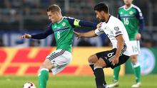 Up close: Northern Ireland skipper Steven Davis is closed down by Sami Khedira in Hannover last night