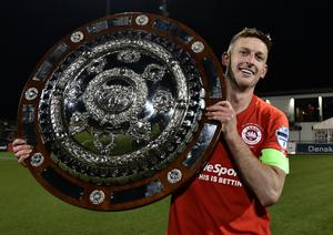 Larne captain Jeff Hughes struck the winning penalty before getting his hands on the County Antrim Shield.