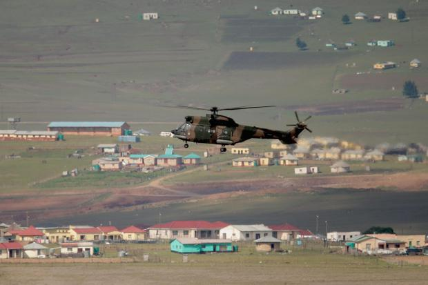 QUNU, SOUTH AFRICA - DECEMBER 15:  A South African Defense Forces helicopter flys over the childhood village of former South African President Nelson Mandela during his state funeral December 15, 2013 in Qunu, South Africa. Mr. Mandela passed away on the evening of December 5, 2013 at his home in Houghton at the age of 95. Mandela became South Africa's first black president in 1994 after spending 27 years in jail for his activism against apartheid in a racially-divided South Africa.  (Photo by Chip Somodevilla/Getty Images)
