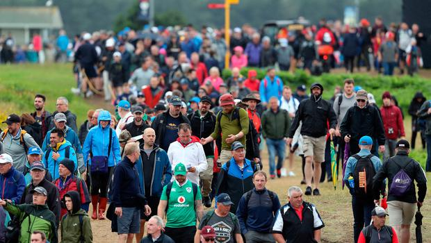 Large crowds follow Northern Ireland's Graeme McDowell on the 2nd green during day four of The Open Championship 2019 at Royal Portrush Golf Club. PRESS ASSOCIATION Photo. Picture date: Sunday July 21, 2019. See PA story GOLF Open. Photo credit should read: Niall Carson/PA Wire. RESTRICTIONS: Editorial use only. No commercial use. Still image use only. The Open Championship logo and clear link to The Open website (TheOpen.com) to be included on website publishing.