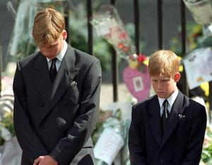 File photo dated 6/9/1997 of Prince William (left) and Prince Harry, the sons of Diana, Princess of Wales, bow their heads as their mother's coffin is taken out of Westminster Abbey. PRESS ASSOCIATION Photo. Issue date: Monday August 27 2007. The Princess died in a car crash in Paris on August 31st 1997.