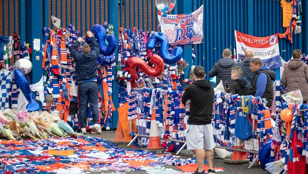Tributes for former Rangers player Fernando Ricksen at Ibrox Stadium. The funeral procession will pass Ibrox Stadium later today before making the journey to Wellington Church. PA Photo. Picture date: Wednesday September 25, 2019. The former Holland international died aged 43 a week ago, six years after being diagnosed with motor neurone disease. Ricksen played more than 250 times for the Light Blues after joining from AZ Alkmaar in 2000, winning two league titles during his time in Glasgow. See PA story SOCCER Ricksen. Photo credit should read: Jane Barlow/PA Wire.