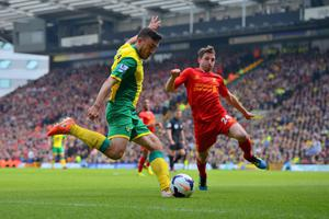 NORWICH, ENGLAND - APRIL 20:  Robert Snodgrass of Norwich City is put under pressure by Joe Allen of Liverpool during the Barclays Premier League match between Norwich City and Liverpool at Carrow Road on April 20, 2014 in Norwich, England.  (Photo by Michael Regan/Getty Images)