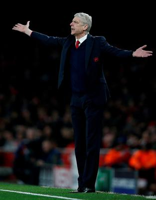 Arsenal's French manager Arsene Wenger shouts instructions to his players from the touchline during the UEFA Champions League round of 16 1st leg football match between Arsenal and Barcelona at the Emirates Stadium in London on February 23, 2016.   / AFP / ADRIAN DENNISADRIAN DENNIS/AFP/Getty Images