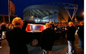 Crowds line the street as a hearse carrying the coffin of Shannon and Munster Rugby club's head coach Anthony Foley passes Thomond Park stadium in Limerick. PRESS ASSOCIATION Photo. Picture date: Wednesday October 19, 2016. Photo credit should read: Niall Carson/PA Wire