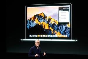 CUPERTINO, CA - OCTOBER 27: Apple CEO Tim Cook speaks on stage during an Apple product launch event on October 27, 2016 in Cupertino, California. Apple Inc. is expected to unveil the latest iterations of its MacBook line of laptops (Photo by Stephen Lam/Getty Images)