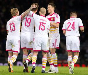 Scotland's Christophe Berra (second left) celebrates his goal during the International Friendly at Hampden Park, Glasgow. PRESS ASSOCIATION Photo. Picture date: Wednesday March 25, 2015. See PA story SOCCER Scotland. Photo credit should read: Kirk O'Rourke/PA Wire. RESTRICTIONS: Use subject to restrictions. Editorial use only. Commercial use only with prior written consent of the Scottish FA. Call +44 (0)1158 447447 for further information.