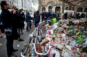 Members of the public look at floral tributes and messages at La Belle Equipe cafe on Rue de Charonne following Friday's terrorist attack on November 16, 2015 in Paris, France. (Photo by Jeff J Mitchell/Getty Images)