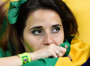 A dejected Brazil fan looks on during the 2014 FIFA World Cup Brazil Semi Final match between Brazil and Germany at Estadio Mineirao on July 8, 2014 in Belo Horizonte, Brazil.  (Photo by Buda Mendes/Getty Images)