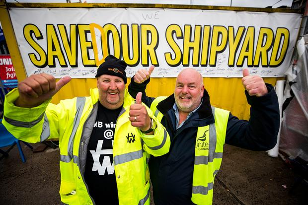 Harland and Wolff workers Barry Reid (left) and Joe Passmore celebrate following the announcement that the Belfast shipyard has been saved after it was bought for £6 million by InfraStrata, a company that works on energy infrastructure projects. PA Photo. Picture date: Tuesday October 1, 2019.