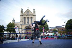 Wrestlers entertain the public during the culture night outside St Anne's Cathedral in Belfast. Picture by Peter Morrison